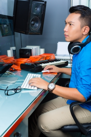 Photo for Asian musician, producer or mixer in sound studio - Royalty Free Image
