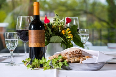 Arrangement with wine bottle and bred in a fine dining restaurant