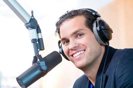 Photo for Presenter or host in radio station hosting show for radio live in Studio - Royalty Free Image