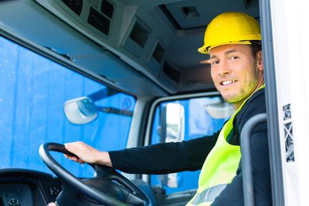 Foto de driver driving with the truck over building or construction site - Imagen libre de derechos