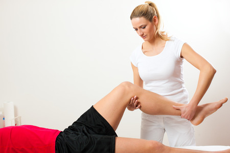 Photo for Patient at the physiotherapy doing physical exercises with his therapist - Royalty Free Image