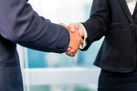 Photo for Close up of business people shaking hands - Royalty Free Image