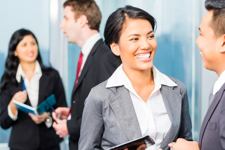 Foto de Portrait of Asian businesspeople talking - Imagen libre de derechos
