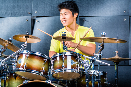 Photo for Asian professional musician drummer playing drums in recording studio - Royalty Free Image