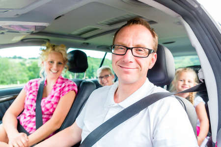 Photo for Family driving in car with seat belt fastened - Royalty Free Image