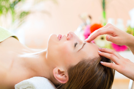 Foto de Wellness - woman receiving head or face massage in spa - Imagen libre de derechos