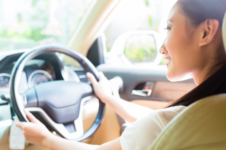 Photo for Asian woman driving new car - Royalty Free Image