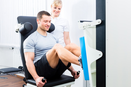 Photo for Patient at the physiotherapy doing physical exercises using leg press in sport remobilization - Royalty Free Image