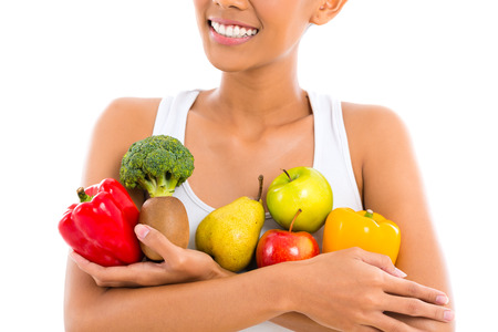 Foto de Asian woman eating healthy fruit - Imagen libre de derechos