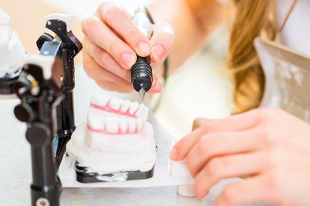 Foto de Dental technician producing denture - Imagen libre de derechos