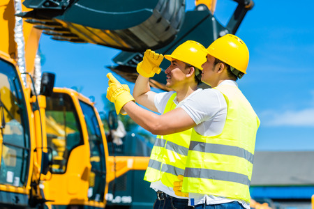 Foto für Asian worker at construction machinery of construction site or mining company - Lizenzfreies Bild