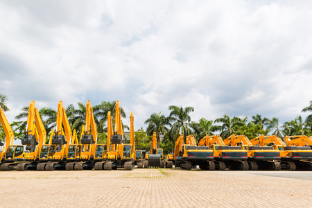 Photo pour Asian Vehicle fleet with construction machinery of building or mining company - image libre de droit