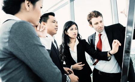 Photo pour International business team on flipboard - image libre de droit