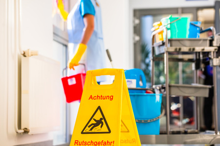 Warning sign on floor in cleaning operation