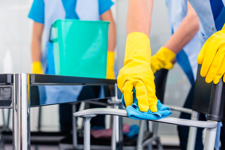 Photo pour Commercial cleaning crew ladies working as team in office - image libre de droit