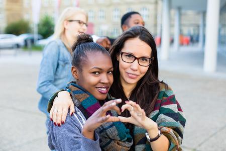 Foto de Diversity friends in city, group of African, Asian and Caucasian people - Imagen libre de derechos