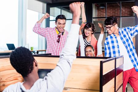 Foto de Start-up business people in cubicles working together having success - Imagen libre de derechos