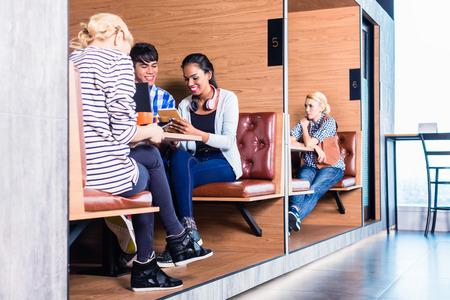 Foto de Creative business people in coworking space having meetings in cubicle offices - Imagen libre de derechos