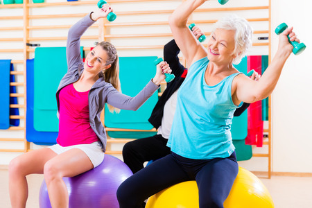 Photo for Group of senior and young people at physiotherapy doing exercises - Royalty Free Image