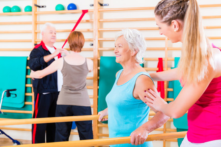 Photo for Seniors in physical rehabilitation therapy with trainer - Royalty Free Image