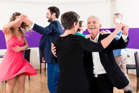 Foto de Group of people dancing in dance class having fun - Imagen libre de derechos