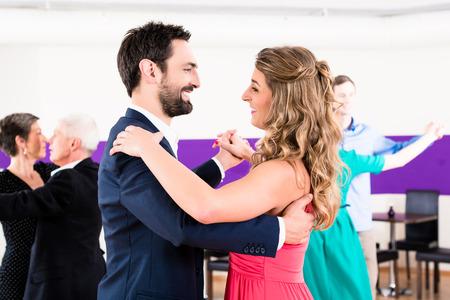 Foto de Young and senior couples getting dance lessons - Imagen libre de derechos
