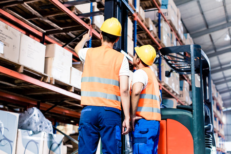 Photo for Worker team taking inventory in logistics warehouse - Royalty Free Image