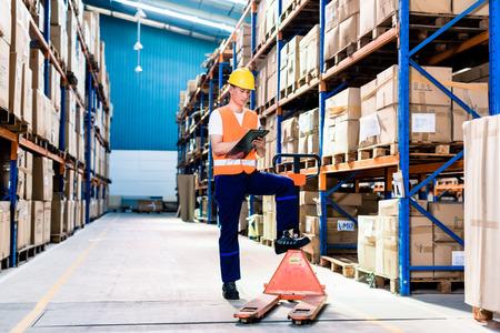 Photo pour Asian man in industrial warehouse checking list - image libre de droit