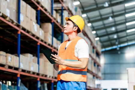 Photo for Worker taking inventory in logistics warehouse - Royalty Free Image
