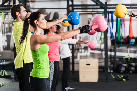 Photo for Functional fitness workout in sport gym with kettlebell - Royalty Free Image