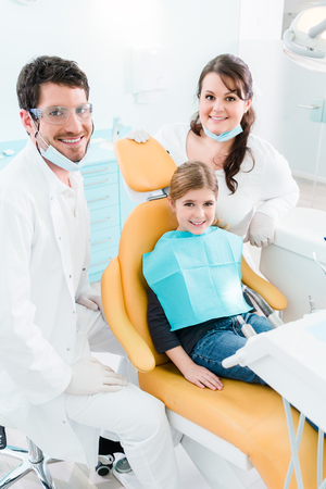 Foto de Dentist treating child in his surgery, there is no need to drill a tooth - Imagen libre de derechos