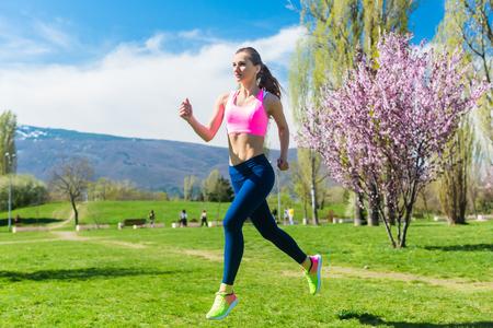 Foto de Woman running fast for sport on sunny day - Imagen libre de derechos