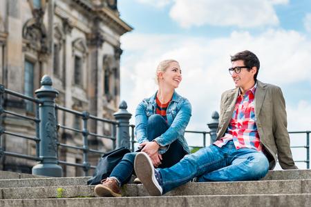 Foto de tourists, woman and man, enjoying the view from bridge at the Museum Island in Berlin - Imagen libre de derechos