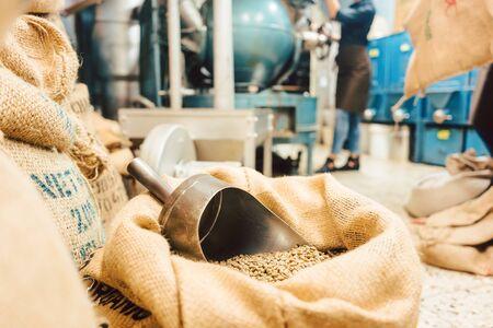 Foto de Bags of coffee in roastery or wholesale storage waiting to be roasted or sold - Imagen libre de derechos