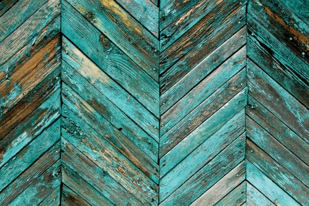 Close up of gray and blue wooden fence mural