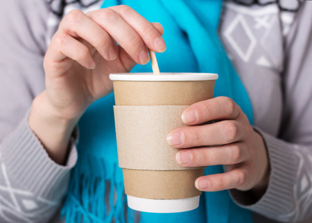 Foto für Special Cup for hot coffee takeaway, in hands of woman - Lizenzfreies Bild