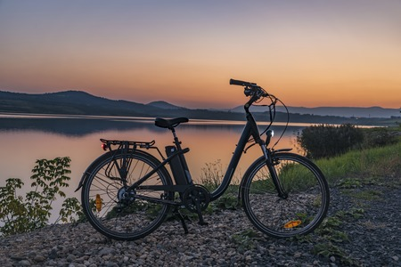 Photo pour Electric bicycle with lights in summer evening - image libre de droit