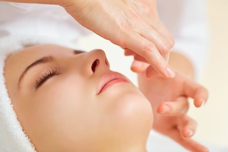 Foto de Beautiful woman at a facial massage at a spa salon. - Imagen libre de derechos