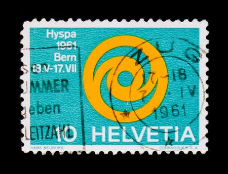 Foto de MOSCOW, RUSSIA - SEPTEMBER 3, 2017: A stamp printed in Switzerland shows Emblem of Exhibition HYSPA 1961, Hyspa serie, circa 1961 - Imagen libre de derechos