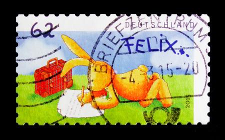 Foto de MOSCOW, RUSSIA - OCTOBER 21, 2017: A stamp printed in German Federal Republic shows Post by Felix, serie, circa 2015 - Imagen libre de derechos