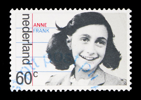 Foto de MOSCOW, RUSSIA - MAY 13, 2018: A stamp printed in Netherlands shows Family portrait of Anne Frank, Occupation and liberation serie, circa 1980 - Imagen libre de derechos