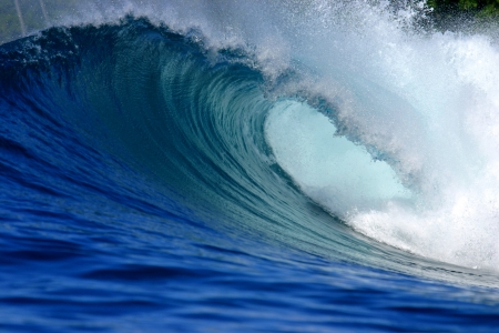 Blue tropical ocean surfing wave