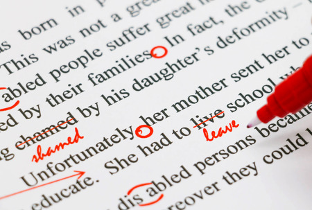 Photo for closeup red marks on proofreading english document - Royalty Free Image