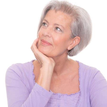 Foto für Thinking senior woman in front of white background - Lizenzfreies Bild