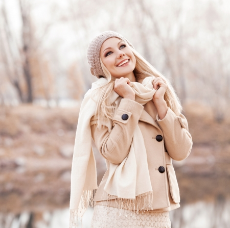 beautiful young blond woman spending time in the autumn park