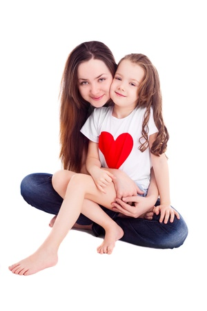 happy mother and her six year old daughter wearing T-shirt with big red heart, isolated against white background