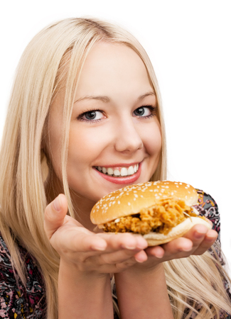 beautiful woman eating burger, isolated against white background