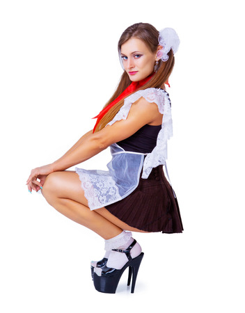 Photo for attractive striptease dancer dressed as a schoolgirl against a chalkboard in the classroom - Royalty Free Image
