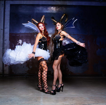 Foto de beautiful sexy young models wearing Halloween costume of leather and horns - Imagen libre de derechos