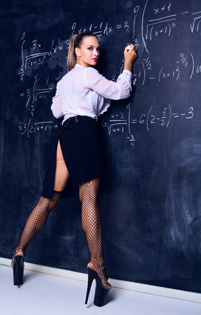 Photo for dancer dressed as teacher against a chalkboard in the classroom - Royalty Free Image